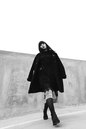 Noir minimalism Girl Beauty Fashion Attitude Model Minimalist Architecture Photography Pose Blackandwhite Fashion Photography Running Sport Art Bw Minimalism Outfit Unique Love Portrait Standing Well-dressed Dress Coat Posing Trench Coat Winter Coat Go Higher Stories From The City Inner Power EyeEmNewHere Visual Creativity