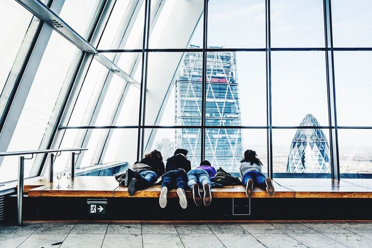Where friends comes closer Window Architecture Built Structure Men Lifestyles Togetherness Skyscraper People Liedown Real People Feets Friends Sky Garden Resting Day Body Part