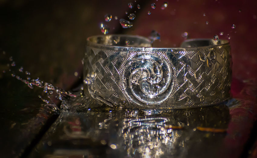 This is an older photo. Took this around 2010 with my old Nikon D80. It was a test shot to see if the idea would turn out ok. I shot several copper cuff's for a local silversmith Experimental Nikon Nikon D80 Rain Close-up Drops Of Water Product Shot Silver Cuff Splash Water
