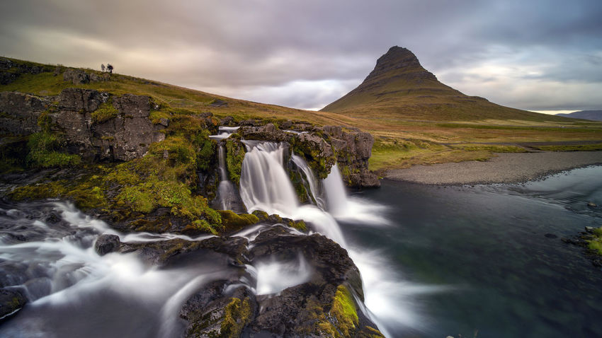 Kirkjufellsfoss waterfall is situated in Kirkjufellsa river and located near the proud mount Kirkjufell by Grundarfjordur town at the northern side of Snaefellsnes peninsula in West Iceland. Scenics - Nature Water Beauty In Nature Long Exposure Rock Cloud - Sky Motion Waterfall Nature Flowing Water Environment Sky Blurred Motion Mountain Rock - Object No People Solid Non-urban Scene Flowing Outdoors Stream - Flowing Water Power In Nature Kirkjufellsfoss Iceland Autumn