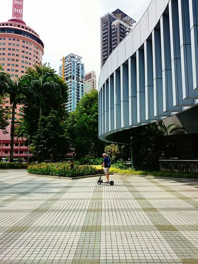 Scooting below the tax department. Street Photography Architecture Urban Geometry Travel Photography Travel Singapore Lines & Curves