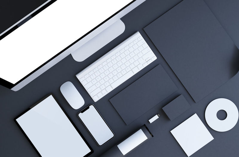 High angle view of computer and mobile phone on table at office