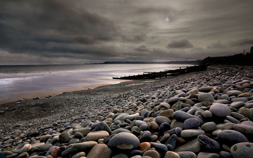 Amroth beach at sunset Beach Beauty In Nature Cloud - Sky Day Nature Outdoors Pebble Scenics Sea Shore Tranquil Scene Water