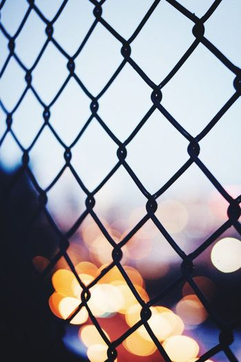 Street photography Chainlink Fence Security Protection Fence Safety Metal Sky No People Close-up Outdoors City Sunset Crisscross Nature Day Long Goodbye EyeEmNewHere Welcome To Black