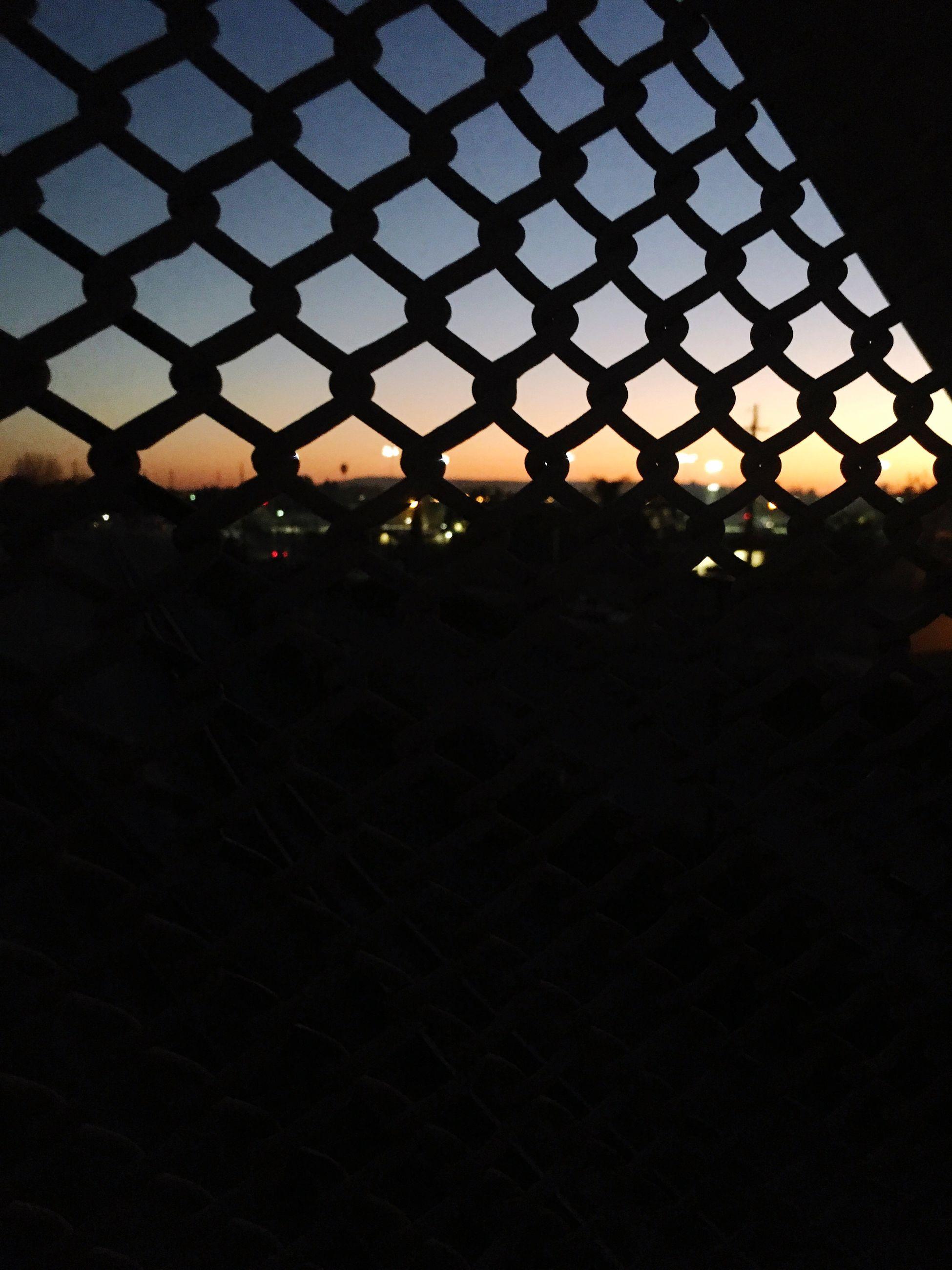 illuminated, night, sunset, silhouette, built structure, architecture, dark, pattern, building exterior, indoors, no people, orange color, sky, dusk, city, lighting equipment, light - natural phenomenon, shadow, metal