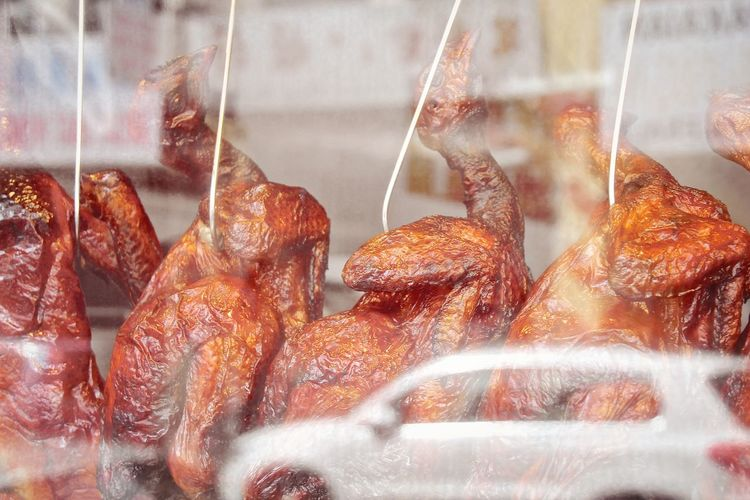 Close-Up Of Roasted Duck Meat At Window Display