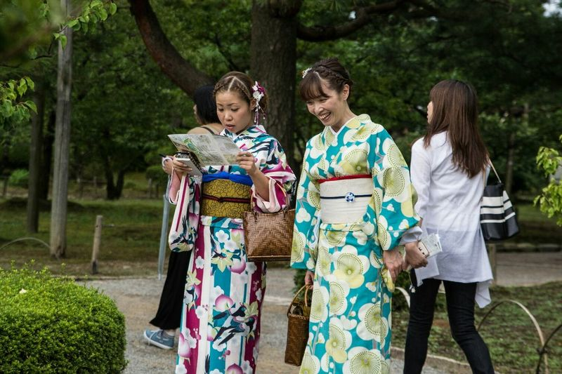 People And Places Togetherness Tree Tree Trunk Lifestyles Leisure Activity Full Length Casual Clothing Person Front View Holding Looking At Camera Footpath Vacations Day Tourism Focus On Foreground Young Adult Green Color Maiko YUKATA Girl Girls Garden
