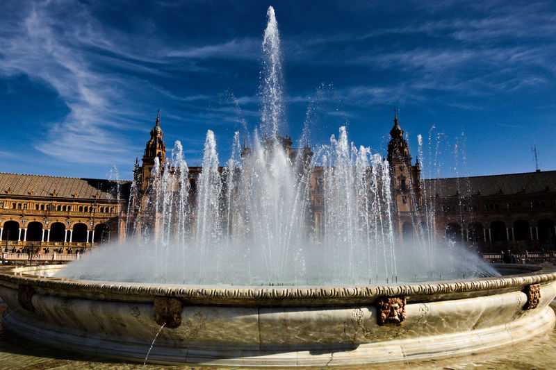 Panoramic view of fountain against buildings in city