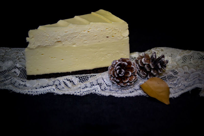 a slice of white chocolate cream cake for Christmas dinner Slice Of Cake December Love On Christmas Christmas Food Christmas Christmas Sweets Happy Food And Drink Sweet Food Table No People Food Dessert Indoors  Black Background Freshness Close-up
