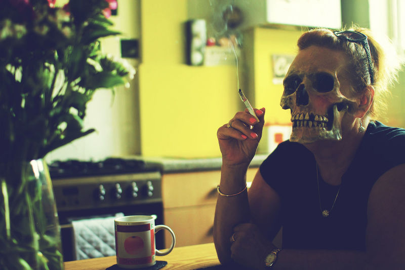 Jean Skull Dark Creepy Skeleton Make-up Kitchen Photoshop Horror Photography Horror Portrait Coffee Sitting Happiness Smiling Drink Women Cheerful Standing Out From The Crowd Smoking Cigarette  Smoking Issues Unhealthy Living No Smoking Sign Tobacco Product Smoking - Activity Bad Habit Beverage