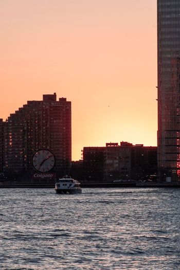 Hudson River Battery Park Pink Sky Building Exterior Architecture Built Structure Sky Sunset City Water Transportation Clear Sky Mode Of Transportation No People Orange Color Nautical Vessel Office Building Exterior Tall - High Cityscape Building Waterfront Nature Sea