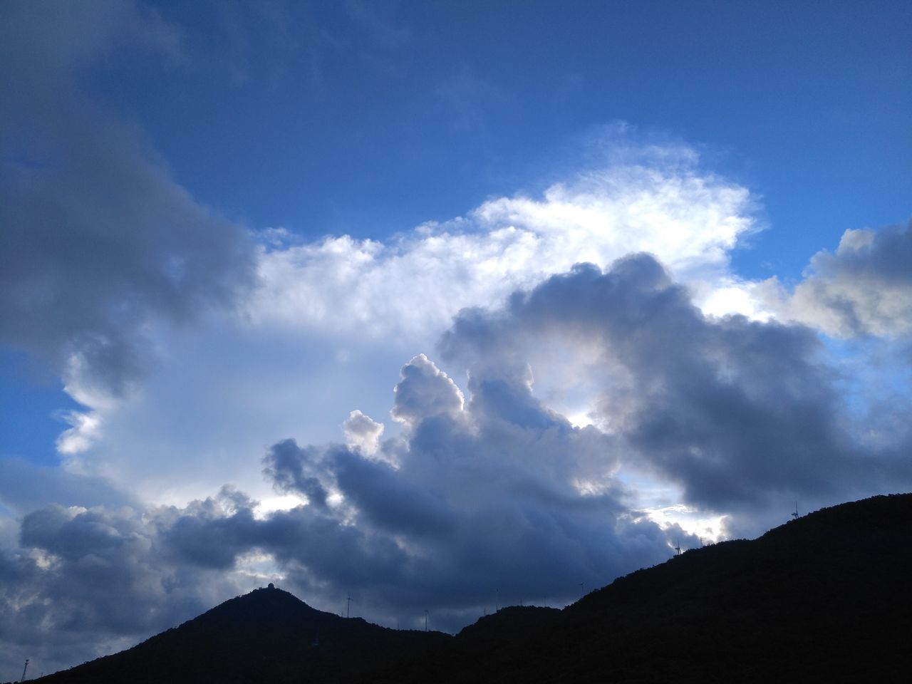 sky, cloud - sky, nature, scenics, low angle view, beauty in nature, tranquility, silhouette, tranquil scene, blue, outdoors, no people, day, mountain