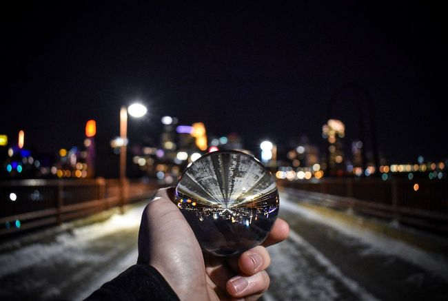 Inverted lensball in city Eyeem Market EyeEm Masterclass Eyeemphotography EyeEm Best Edits EyeEmBestPics EyeEm Selects EyeEmNewHere Lensball EyeEm Best Shots Human Hand Illuminated Night Human Body Part Personal Perspective Wristwatch Lifestyles Building Exterior Cityscape Road Close-up Architecture Holding Sky Focus On Foreground Outdoors City