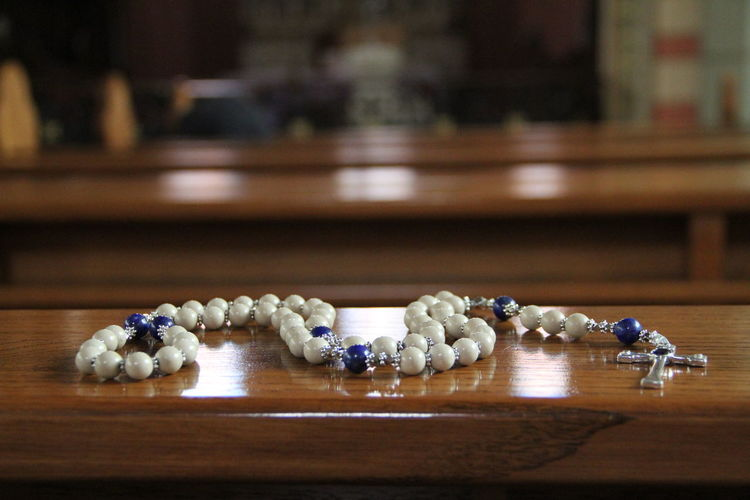 Close-Up Of Rosary On Table