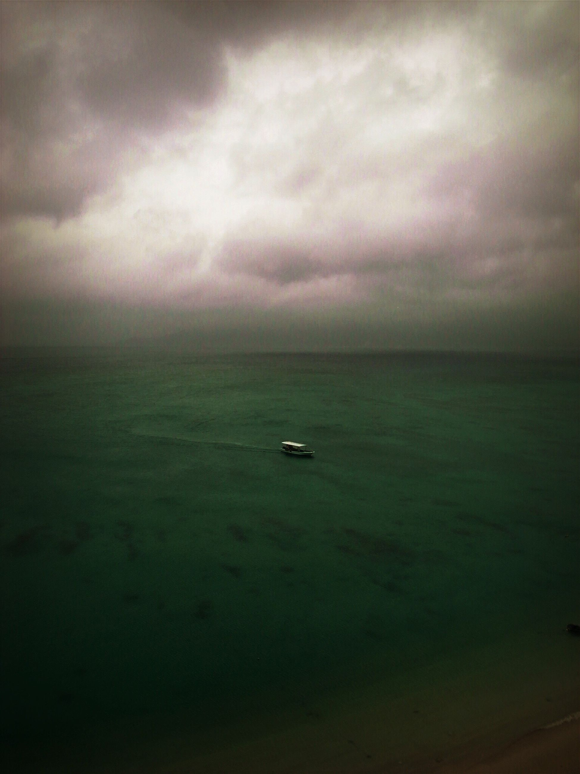 sea, horizon over water, sky, water, scenics, tranquil scene, beauty in nature, tranquility, cloud - sky, transportation, nautical vessel, nature, mode of transport, cloudy, boat, idyllic, waterfront, seascape, cloud, weather