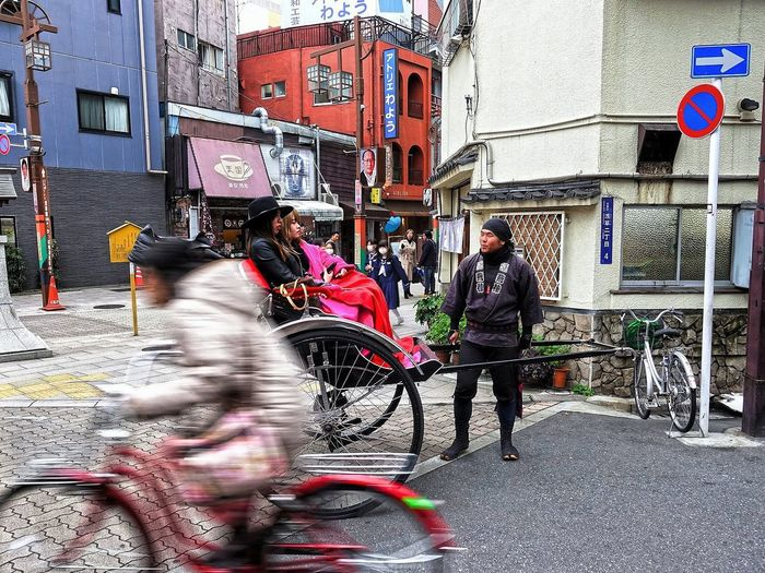 Architecture Building Exterior Street Built Structure City Real People City Street Land Vehicle City Life Bicycle Outdoors Transportation Road People Rickshaw Tour Asakusa,tokyo,japan