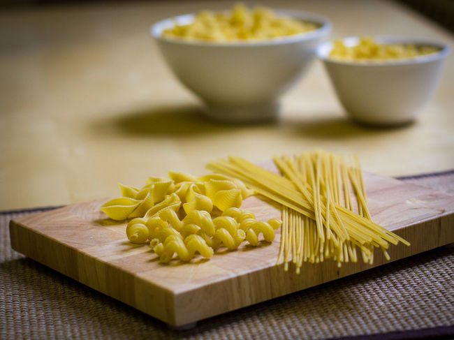 Bowl Close-up Cutting Board Day Dried Pasta Food Food And Drink Freshness Healthy Eating Indoors  Italian Food No People Pasta Raw Food Table Uncooked Pasta Vegetable Yellow Still Life Paint The Town Yellow Food Stories