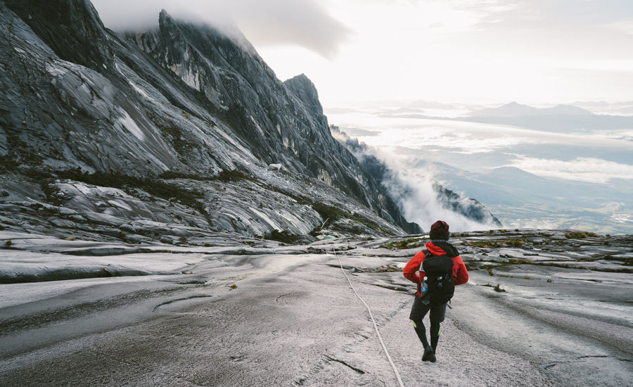 Walking down from the top Adult Adventure Beauty In Nature Cold Temperature Day Helmet Leisure Activity Lifestyles Men Motion Mountain Mountain Range Nature One Man Only One Person Only Men Outdoors Real People Rear View Rock - Object Scenics Sky Snow Waterfall Young Adult