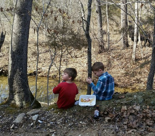 Fun Sharing  2 Boys Children Missouri Ozarks United States Gravel Road Creek Bank Best Friends Tree Sitting Togetherness Friend Leisure Recreation  Free Time Relaxing Moments Human Relaxed Moments Picnic Blanket Picnic Growing Preschooler