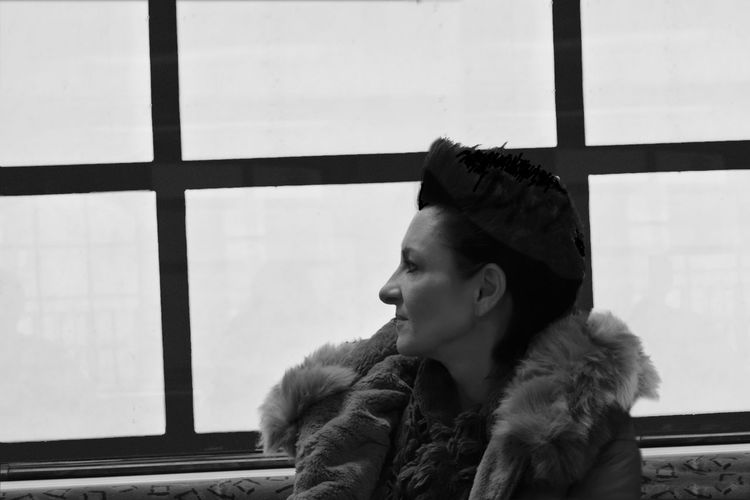 Lost in thoughts Black & White Portrait Of A Woman Black And White Blackandwhite Close-up Headshot Looking Through Window One Person Portrait Profile View Real People Warm Clothing Window Young Adult Be. Ready. Be. Ready. The Portraitist - 2018 EyeEm Awards