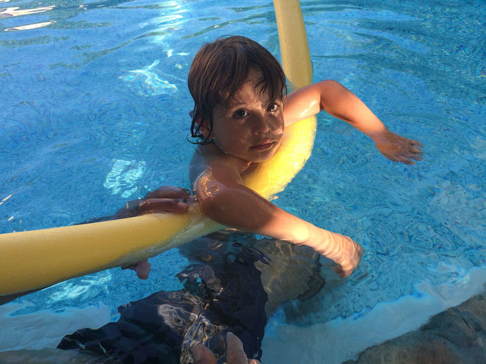 My Son Blue Boy Cute Day Enjoyment Full Length Fun Learning To Swim Leisure Activity Lifestyles Portrait Water Natural Light Portrait