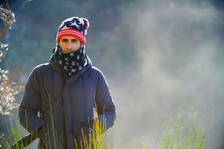 Day Growth Headwear Lifestyles Looking At Camera Nature One Person Outdoors People Portrait Real People Standing Stars And Stripes Warm Clothing Young Adult
