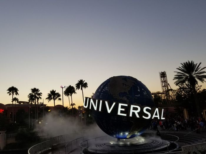 Universal Studios Orlando Universal Studios  Large Ball Letters Water Wording Evening Lights Orlando Universal New Magical Place On Esrth Water Tree Palm Tree Travel Destinations Night No People Outdoors