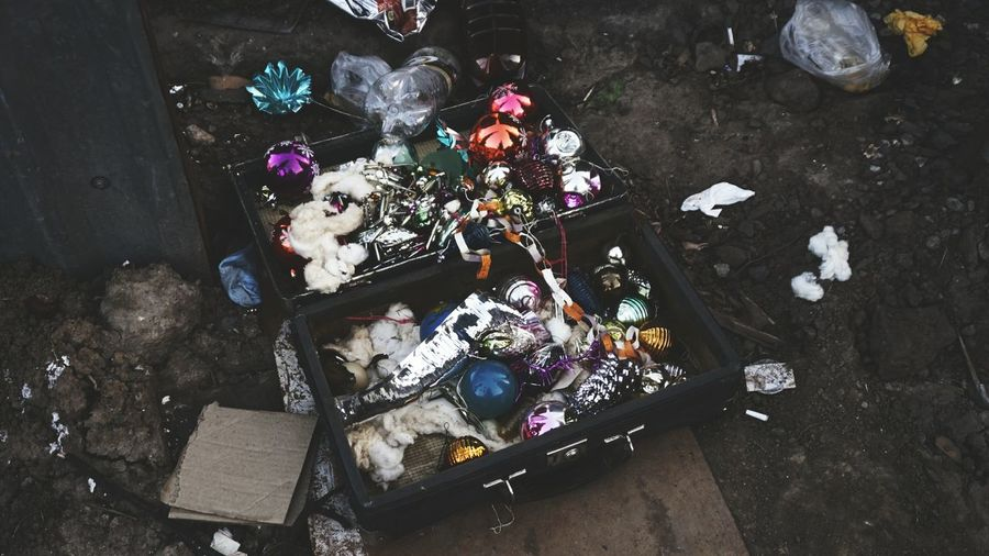 High angle view of abandoned decoration material in bag at junkyard