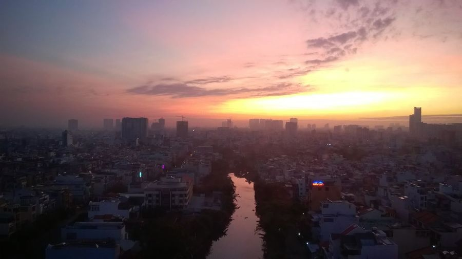 Aerial View Reflection City View  Morning Canal Daylight Sunrise Outdoors Saigon Vietnam Skyline Suburbia Outdoor Photography Urban Skyline Modern Skyscraper Sunset Business Fog Downtown District Business Finance And Industry Tower Atmospheric Mood Smog Moody Sky Urban Sprawl Dramatic Sky Overcast