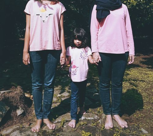 Triple Outdoors Standing Casual Clothing Day Females Childhood Togetherness Mother Bonding Family People Daughter Three People Child Girls Young Adult Adult Love Real People