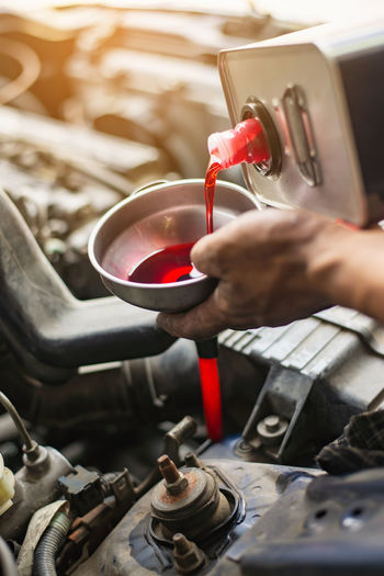 Human Hand Hand Indoors  One Person Holding Real People Working Occupation Workshop Metal Human Body Part Machinery Industry High Angle View Heat - Temperature Business Making Men Work Tool Automatic Transmission Gear Oil Car Petroleum Service
