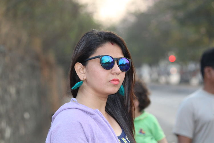 Close-Up Of Beautiful Young Woman Wearing Sunglasses