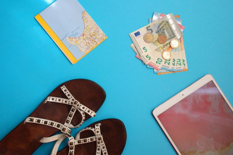 Indoors  Colored Background Blue Paper Currency Currency Shoe Blue Background High Angle View Finance Studio Shot Communication Directly Above Sandals Tablet Technology Map Coins Travel Flat Lay Travel Flat Lay Money Euro Currency Shoe Indoors  Travel