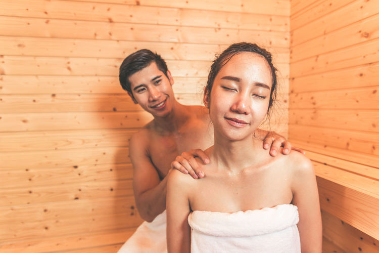 Young Couple Sitting In Sauna