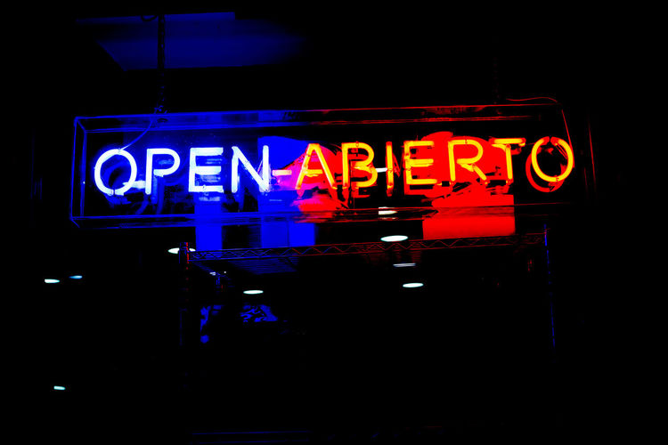 """Neon shop """"Open"""" (In Spanish and English) store sign at night in street Open Sign Signboard Store Store Sign Shop Neon Neon Lights Neon Sign Window Door Restaurant Backgrounds Background Retail  Symbol Glass Bar Welcome Hours Advertising Entrance Board Message Retro"""