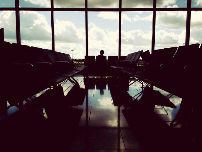 People in airport against sky