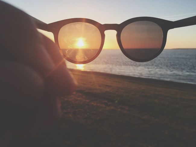 Human Hand Sunset Human Body Part One Person Human Finger Sun Sunlight Sea Vision Close-up Sky Real People Outdoors Nature Beauty In Nature Eyesight Day