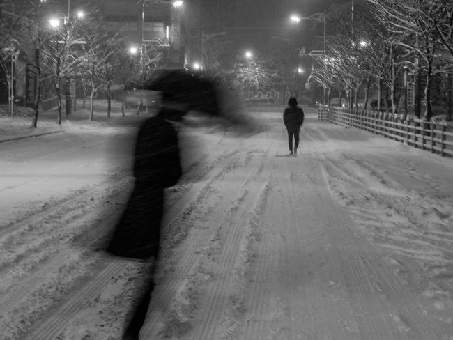 Businessman City Cold Temperature Illuminated Men Night Noir Outdoors People Silhouette Of A Man Snow Street Light Umbrella Walking On Snow Warm Clothing Winter Winter Walk