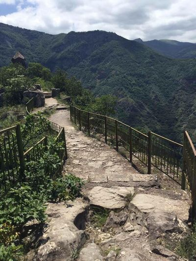 Mountain Railing Nature Mountain Range Beauty In Nature Scenics Steps Day Tranquility Outdoors Tranquil Scene Green Color Sky Landscape No People Architecture