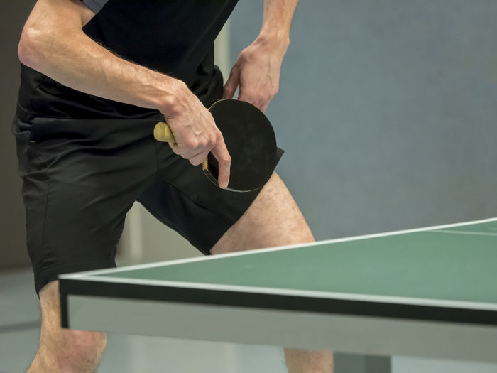 table tennis player waiting for the ball Adult Day Human Body Part Human Hand Indoors  Leisure Activity Lifestyles Men People Real People Sport Sportsman Standing Table Tennis Table Tennis Bat Table Tennis Table