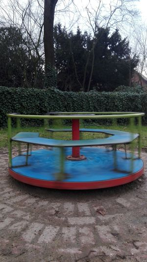 Bonita infancia! Playground Park - Man Made Space Tree Blue Outdoors Childhood Outdoor Play Equipment Day No People Merry-go-round Water Slide - Play Equipment Carousel Nature
