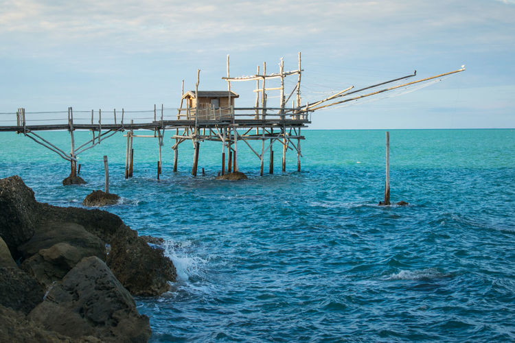 "Traditional fishing machine in Abruzzo, Italy: the ""trabocco"" Abruzzo Architecture Characteristic Construction Machine Mediterranean Sea Typical Wood Coast Fisherman Fishing Fishing Technique Fishnet Italian Italy Old Structural Wood Trabocchi Coast Traditional First Eyeem Photo"