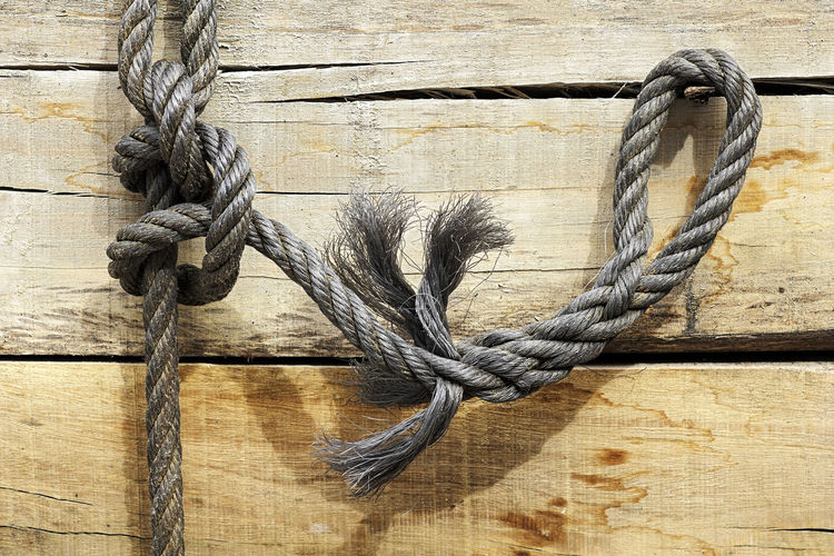 Close-up of sailor knot on wooden plank