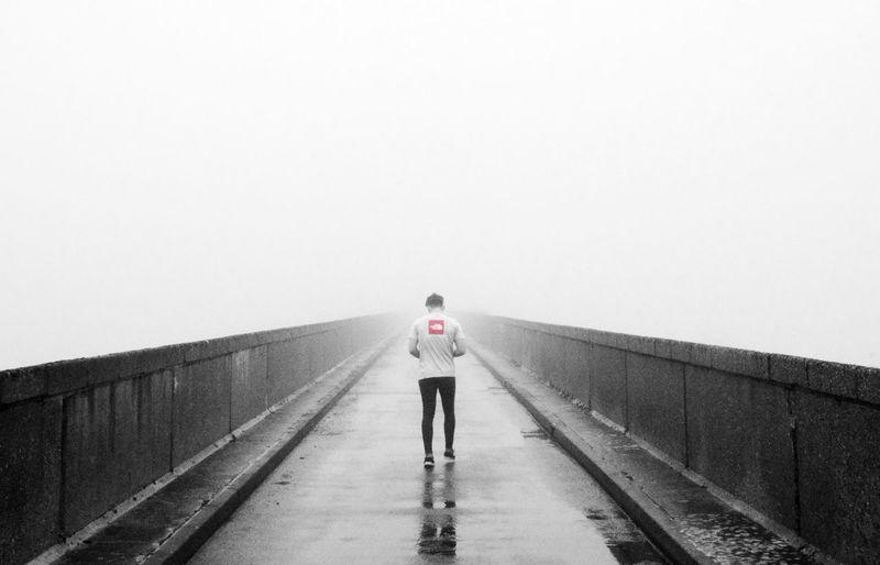 Full Length Of Man Walking On Pier