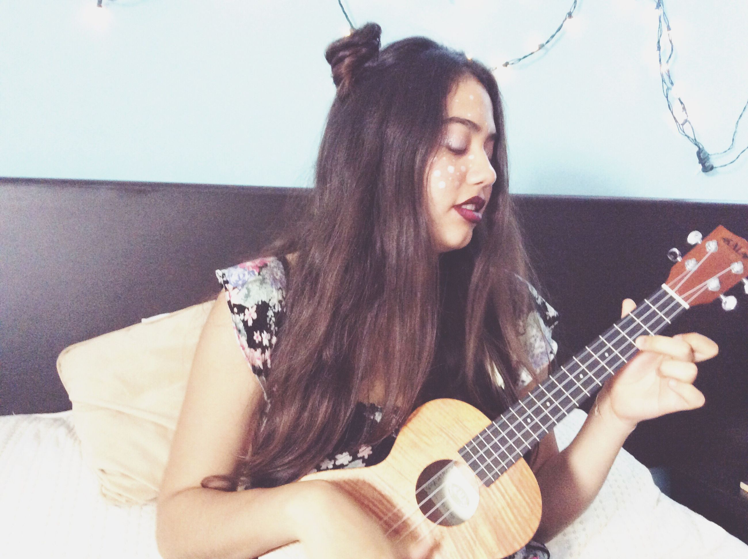 young adult, music, young women, lifestyles, home interior, long hair, indoors, one person, real people, sitting, beauty, holding, playing, arts culture and entertainment, musical instrument, guitar, one young woman only, human hand, plucking an instrument, musician, people, adult, day
