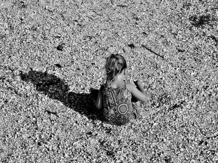 Literally in a sea of shells... Shells Conchshell Childplay Blackandwhite Seaside_collection Black & White B&w Playing Children Playing Child siempre