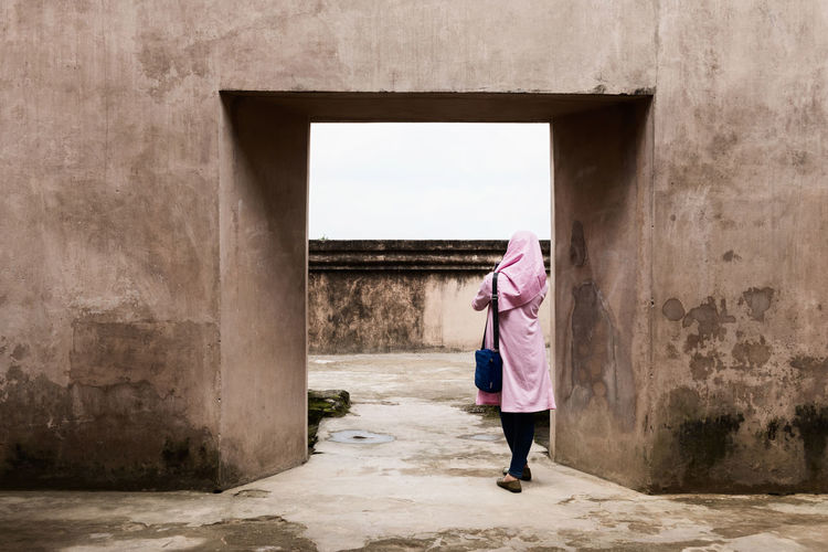 Lady In Pink Architecture Building Exterior Built Structure Conceptual Eye4photography  EyeEm Best Shots EyeEm New Here Fine Art Photography Framed Full Length INDONESIA Muslim Muslim Woman One Person One Woman Only Pink Pink Color Standing Texture Textures The Secret Spaces Travel Photography Unrecognizable Person Young Woman EyeEm Diversity EyeEm Diversity Art Is Everywhere Break The Mold The Architect - 2017 EyeEm Awards Neighborhood Map Place Of Heart Neon Life Connected By Travel EyeEm Ready   Fashion Stories Colour Your Horizn Stories From The City Adventures In The City #urbanana: The Urban Playground A New Beginning