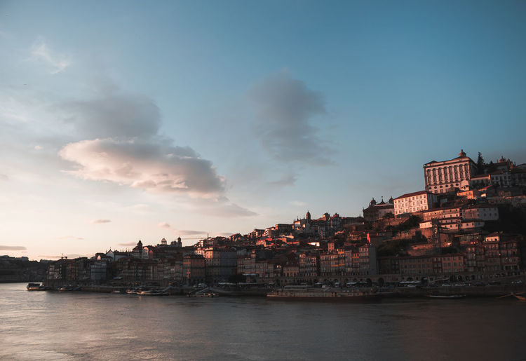Sunset light covering the city of porto and its river douro.