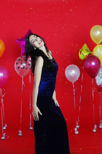 Midsection of woman with balloons