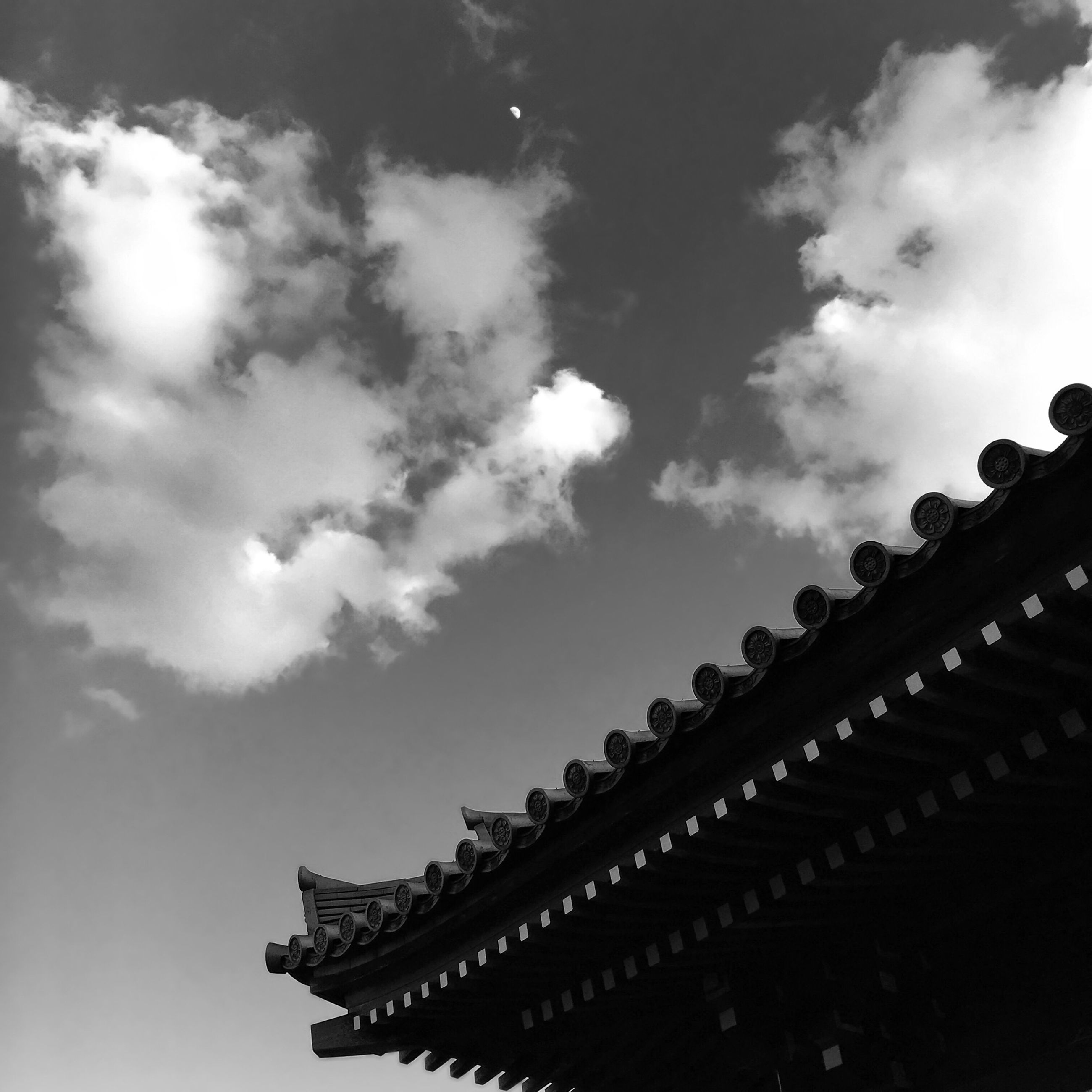 low angle view, sky, architecture, built structure, building exterior, cloud - sky, roof, place of worship, religion, high section, cloud, spirituality, outdoors, silhouette, day, no people, temple - building, cloudy, building, sunlight